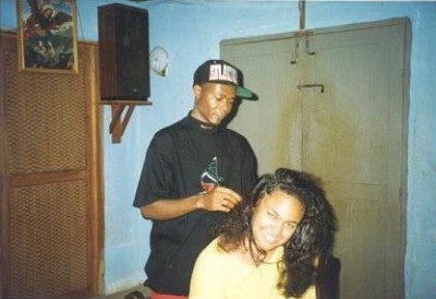 Getting my hair braided in Benin, age 16.